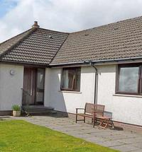 Situated on a working croft just over 3 miles from Fort William this bright and spacious self catering bungalow sleeps up to 7 persons and enjoys w...