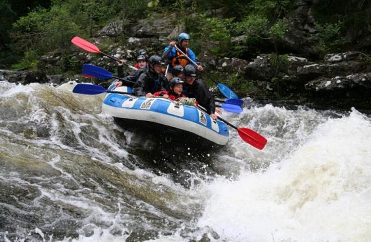 Medium large white water rafting river garry